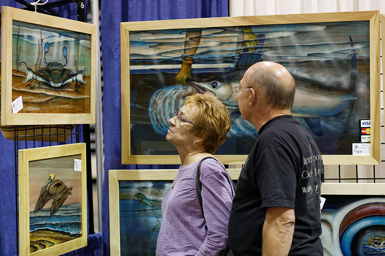 people looking at some artwork